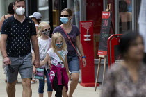 24-07-2020 - Mask up Friday, young family wearing masks in the street, Stratford Upon Avon © John Harris