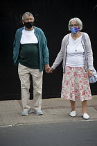29-07-2020 - Elderly couple with face masks holding hands, Stratford Upon Avon © John Harris
