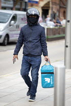 29-07-2020 - Lost Deliveroo worker and delivery box looking for customer, Bancroft Gardens, Stratford Upon Avon © John Harris