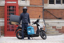 29-07-2020 - Deliveroo worker, delivery box and motor scooter, Stratford Upon Avon © John Harris
