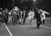 16-06-1975 - Royal Ascot races 1975 men in top hats and morning dress and women in hats arriving at Ascot racecourse, Berkshire © Martin Mayer
