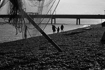12-11-1970 - Family and fishing nets, Deal beach, Kent 1970 on a winter afternoon © Martin Mayer