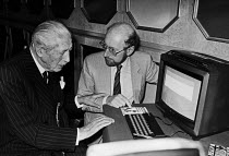 10-11-1983 - Clive Sinclair, Harold Macmillan with a Spectrum ZX computer, 1983 London, launch of new educational software Science Horizons Survival, a ZX Spectrum computer game developed by Five Ways Software and... © NLA