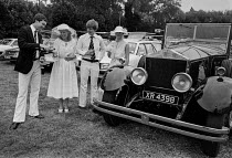 08-09-1979 - Henley Royal Regatta 1979 drinking champagne by the vintage Rolls Royce, Henley on Thames. 1923 Rolls Royce 40/50 Silver Ghost with Hooper Cabriolet coachwork. Originally supplied to Lord Stanley in 1... © NLA