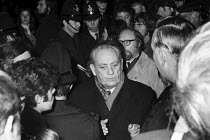 12-12-1971 - Tom Driberg MP 1971, journalist, High Anglican churchman and possible Soviet spy, goes past a Festival of Light lobby into St Paul's Cathedral, London. © Peter Arkell