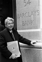 28-04-1982 - Donald Woods, Barclays Bank Shadow Report, 1982, Barclays Bank HQ. South African anti-Apartheid journalist, author and South African former newspaper editor outside the bank HQ in London with a report... © Peter Arkell