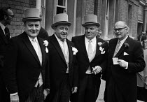 20-06-1972 - Royal Ascot races 1972. Men in top hats and morning dress and cigars talking © Peter Arkell