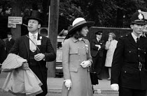 20-06-1972 - Royal Ascot races 1972. men in top hats, morning dress with cigar and women in hats arriving at Ascot racecourse, Berkshire © Peter Arkell