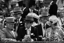 15-06-1981 - Royal Ascot races 1981, men in top hats and morning dress, woman in hat, Ascot racecourse, Berkshire © Peter Arkell
