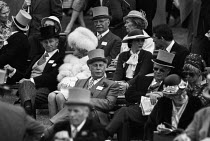 16-06-1981 - Royal Ascot races 1981, men in top hats and morning dress, woman in hat, Ascot racecourse, Berkshire © Peter Arkell