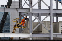 15-08-2020 - Redevelopment of Coventry Railway Station, Construction worker on a hydraulic lift amongst the girders © John Harris