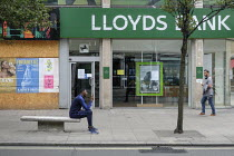 18-08-2020 - Boarded up shop and closed branch of Lloyds Bank. Shoppers, Oxford Street, London. Easing of Covid-19 lockdown restrictions. © Philip Wolmuth