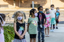 27-08-2020 - Michigan USA. First day of school, pupils practicing lining up six feet apart, St. Clare of Montefalco Catholic School. The school has a diverse student body from Grosse Pointe and Detroit. © Jim West