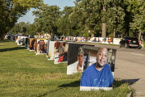 29-08-2020 - Detroit, USA: Memorial to Covid-19 Victims. 900 portraits of those lost to Coronavirus in a public memorial. Faces on billboards of Detroit residents who died lining the roads of Belle Isle State Park... © Jim West