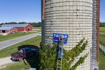 14-09-2017 - Michigan, USA Farmer putting up Trump election banner on Silo of Michgain Farm. Broc Reaser hanging a Trump banner on the silo of farmer John Seeber. Seeber said he wanted the banner high on the silo... © Jim West