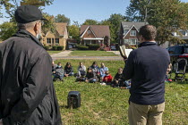 03-10-2020 - Detroit, USA. Neocatechumenal Way Missionaries leading a procession followed by an outdoor religious service in a vacant lot. The Neocatechumenal Way is a Catholic lay movement that sends missionary f... © Jim West