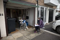 16-10-2020 - Accountant and elderly client meeting in her open garage for safety. Halesowen. Meeting safely socially distanced with airflow to avoid infection during Coronavirus epedemic. Cilla Watts (Cooke and Wa... © John Harris
