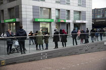 30-10-2020 - Local families queuing for free Papa John's pizza helping families in need and on free school meals in the school holiday. Crossharbour, Isle of Dogs, Tower Hamlets, East London. © Jess Hurd