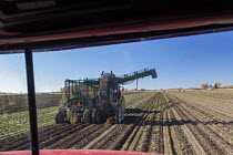 28-10-2020 - Michigan USA. Tractor pulling an Art's Way 692-Z Sugar Beet Harvester on a Michigan farm. Michigan Sugar Company- a farmer owned cooperative- makes about 1.1 billion pounds of sugar each year. © Jim West