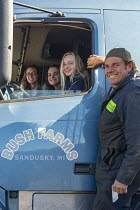 28-10-2020 - Michigan, USA-Sugar beets harvest Lorry driver Chuck Kirkpatrick by his truck after dropping off a load of sugar beets at the Michigan Sugar Company. His two daughters and their friend look forward to... © Jim West