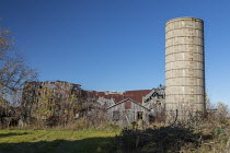 28-10-2020 - Marlette, Michigan - The ruins of a barn and an old concrete silo on a Michigan farm. © Jim West
