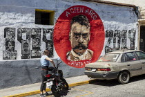 02-02-2020 - Oaxaca, Mexico, street mural honouring Emiliano Zapata, the Mexican revolutionary 100 years after his death. Young woman and motorcycle © Jim West