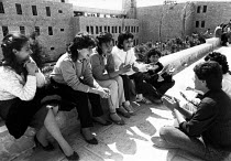 30-03-1984 - Students in discussion, Birzeit University, West Bank, 1984 Land Day. New campus in background © Melanie Friend