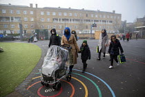 27-11-2020 - Parents bringing children to school wearing face masks, Lansbury Lawrence Primary School during Covid pandemic lockdown, Poplar, East London. © Jess Hurd