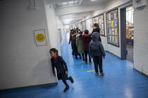 27-11-2020 - Pupils in corridor, Lansbury Lawrence Primary School during Covid pandemic lockdown, Poplar, East London. © Jess Hurd