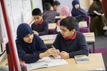 27-11-2020 - Students in Covid class bubble, Pupils in English class, Lansbury Lawrence Primary School during Covid pandemic lockdown, Poplar, East London. Studying Secrets of a Sun King Book by Emma Carrol © Jess Hurd