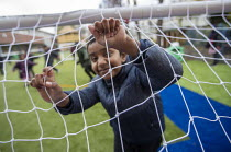 27-11-2020 - Playing football, breaktime, Lansbury Lawrence Primary School during Covid pandemic lockdown, Poplar, East London. © Jess Hurd