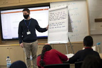 27-11-2020 - Teacher wearing a face mask, class, Lansbury Lawrence Primary School during Covid pandemic lockdown, Poplar, East London. © Jess Hurd