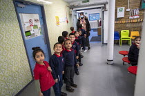 27-11-2020 - Staff wearing face masks. Bubble queuing at Dinner time, Lansbury Lawrence Primary School during Covid pandemic lockdown, Poplar, East London. © Jess Hurd