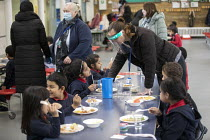 27-11-2020 - Staff wearing face visors. Dinner time, Lansbury Lawrence Primary School during Covid pandemic lockdown, Poplar, East London. © Jess Hurd