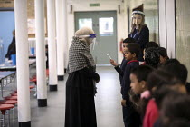 27-11-2020 - Dinner staff wearing face visors. Lansbury Lawrence Primary School during Covid pandemic lockdown, Poplar, East London. © Jess Hurd