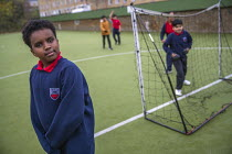 27-11-2020 - Playing football, Lansbury Lawrence Primary School during Covid pandemic lockdown, Poplar, East London. © Jess Hurd