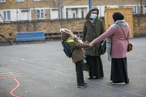 27-11-2020 - Home time, parents collecting their children, Lansbury Lawrence Primary School during Covid pandemic lockdown, Poplar, East London. © Jess Hurd