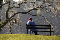 05-11-2020 - Woman sitting on a park bench overlooking the Avon gorge on first day of second lockdown, Autumn, Clifton Downs, Bristol © Paul Box