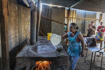 30-01-2020 - San Sebastian Abasolo, Oaxaca, Mexico - making tortillas to sell from home. Rural women in the Tlacolula Valley of Oaxaca benefit from a microfinance loan program run by the nonprofit En Via Foundatio... © Jim West