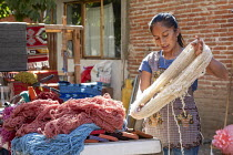 30-01-2020 - Teotitlan del Valle, Oaxaca, Mexico. Traditional cloth production, Dyed yarn for weaving. Rural women in the Tlacolula Valley of Oaxaca benefit from a microfinance loan program run by the nonprofit En... © Jim West
