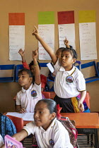 05-02-2020 - Brisas de Zicatela, Oaxaca, Mexico: Enthusiastic pupils with hands in the air, maths class. Escuela Primaria Tierra y Liberdad primary school © Jim West