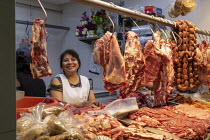 30-01-2020 - Oaxaca, Mexico: Woman selling meat November 20 Market © Jim West