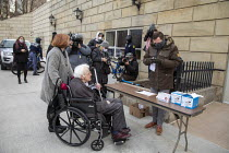 14-12-2020 - Lansing, Michigan USA. Electoral College Meeting. Elector Mike Kerwin (in wheelchair) arriving at the Michigan state capitol to cast his vote for Joe Biden. Kerwin, a long-time UAW activist, is pushed... © Jim West