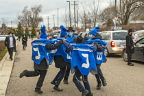 13-12-2020 - Michigan, USA. Boys dancing, Car Top Menorah Parade, fourth night of Hanukkah. Spinning the dreidel © Jim West