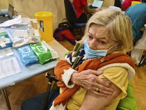 20-12-2020 - Pensioner receiving a Covid-19 Pfizer Vaccination, Clifton, Bristol. NHS Covid 19 Vaccination Service administering COVID-19 mRNA Vaccine BNT162b2 concentrate solution for injection, active immunisati... © Paul Box