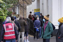 20-12-2020 - Queuing, Covid-19 Vaccination Centre, Essex House Surgery, Barnes, London © Duncan Phillips