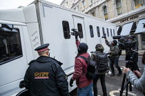 04-01-2021 - Julian Assange arriving for extradition verdict, The Old Bailey, London. Photographers taking photographs of the Prison van carring Assange to the hearing © Jess Hurd