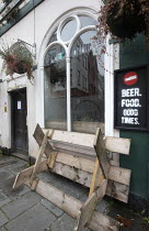 06-01-2021 - Beer, Food, Good Times sign. Pub closed, Covid-19 lockdown King street, Bristol. Unused tables upturned. © Paul Box