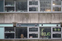 06-01-2021 - F*** BoJo sign, Bristol University student accommodation lockdown, in reference to Boris Johnson and his handling of the Coronavirus Pandenmic. Empty bottles of alcohol line the windows © Paul Box