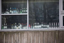 06-01-2021 - Bristol University student accommodation lockdown. Empty bottles of alcohol line the windows © Paul Box